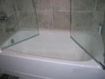 glass enclosure for a bathtub