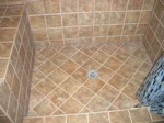 dark tile inlays for a shower floor