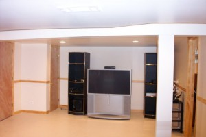 White basement with entertainment center