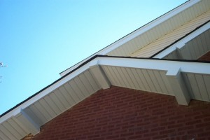 Angled view of the roofing of a brick home